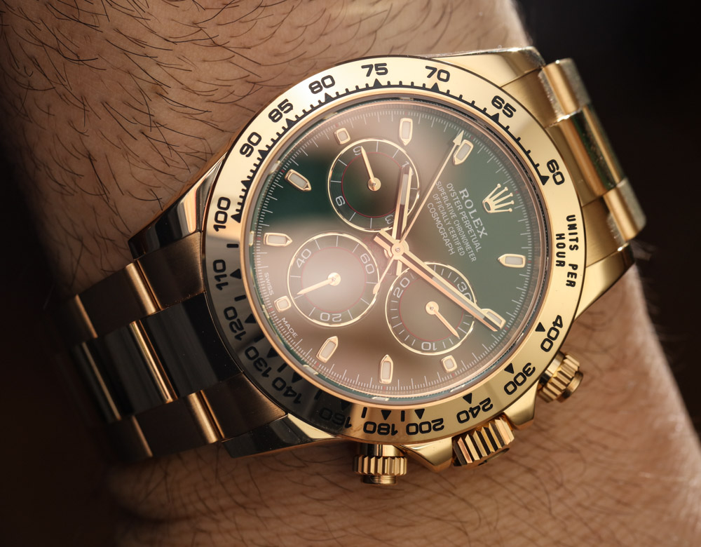 looking 18k yellow gold rolex cosmograph